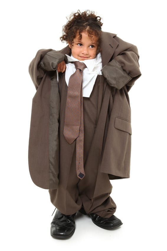 Small child in baggy suit